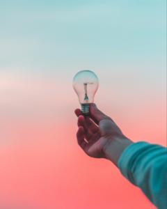 arm holding lightbulb